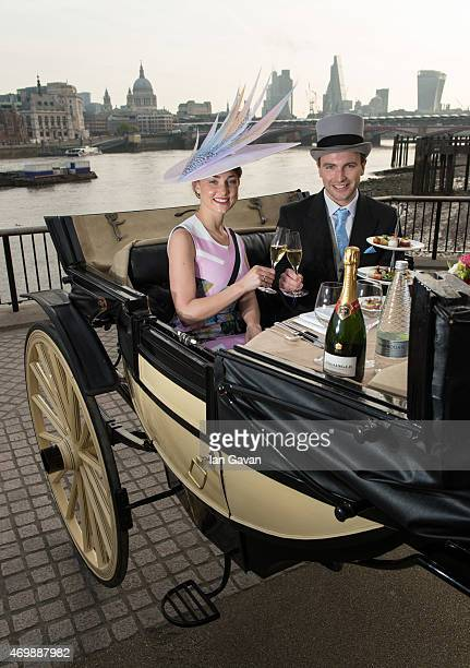 Guests dine on a three course Michelin starred Royal Ascot taster menu in a horse drawn landau carriage on London's South Bank on April 16 2015 in...