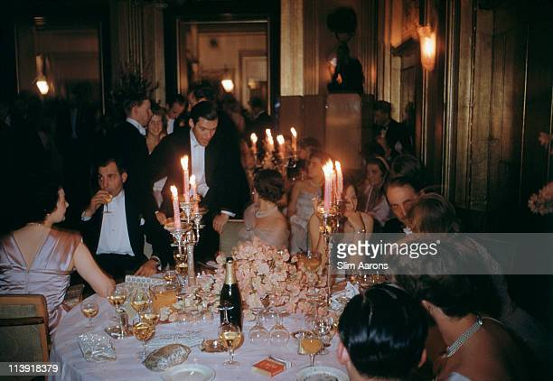 Guests dining at at the Cygnet's ball the annual dance of a fashionable finishing school at Claridge's Hotel in London 1955