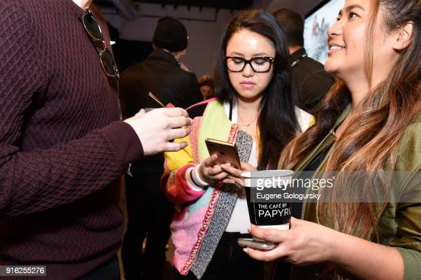 Guests drink coffee during Papyrus and Judith Leiber host Breakfast Mimosas at IMG NYFW The Shows at Spring Studios on February 9 2018 in New York...