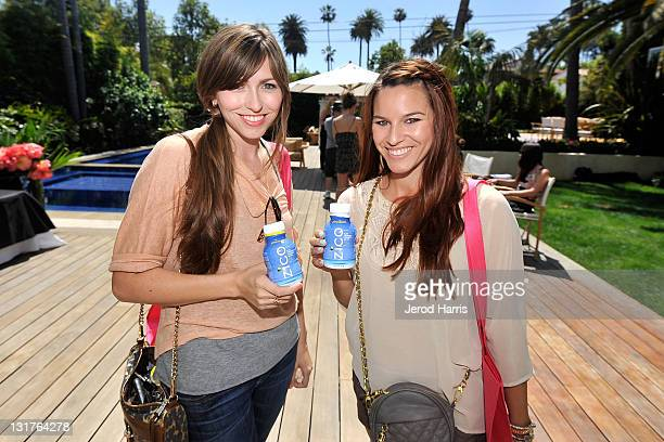 Guests drink Zico coconut water at the Alison Brod Public Relations Los Angeles Summer Style Event on June 15 2011 in Beverly Hills California