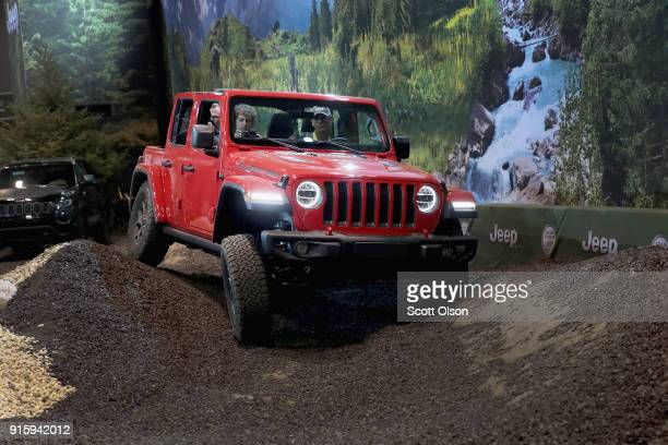 Guests drive a Jeep Wrangler Rubicon on a simulated offroad course at the Chicago Auto Show on February 8 2018 in Chicago Illinois The show is the...