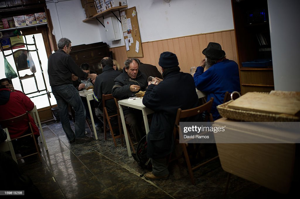 Guests eat a paella, donated by a Michelin starred restaurant, for one Euro at the 'El Chiringuito de Dios' ('The Stall of God') on January 10, 2013 in Barcelona, Spain. The German pastor Wolfgang Striebinger has lived in Barcelona since 1991, originally employed to minister to youths during the Barcelona Olympic Games, he decided to stay and since 2000 has run 'El Chinguito de Dios' (The Stall of God). In his mission to support the homeless, Wolfgang and his volunteers offer a place for up to 200 people to come and have some food daily and also offering them assistance with grooming and clothes. Many of the volunteers are homeless and help out in return for meals and a bed. Wolfgang's ethos is to provide peace, calm and dignity to all those that need it amongst Barcelona's burgeoning homeless population. Due to the economic situation his doors are now also open to the long term unemployed and families with little or no income. According to the latest figures 21.8% of the Spanish populations are living below the poverty line.