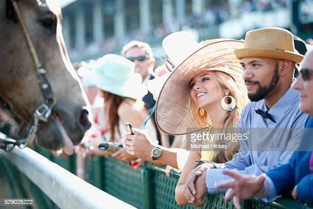 Guests engage with a Kentucky Derby horse at 142nd Kentucky Derby at Churchill Downs on May 7 2016 in Louisville Kentucky