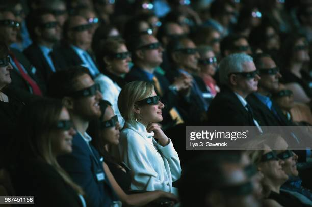 Guests enjoy a 3D film during the Launch Of OceanX a bold new initiative for ocean exploration at the American Museum of Natural History on June 4...