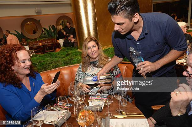 Guests enjoy a Dinner Hosted By Francis Mallmann And Paul Qui during 2016 Food Network Cooking Channel South Beach Wine Food Festival Presented By...