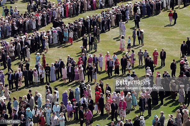 Guests enjoy a Garden Party hosted by Queen Elizabeth II at Buckingham Palace on July 11 2006.