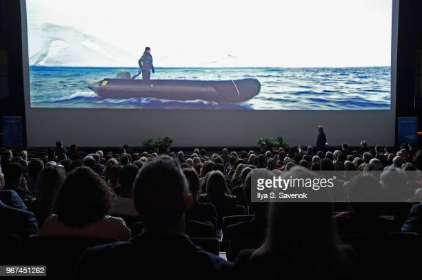 Guests enjoy a screening during the Launch Of OceanX a bold new initiative for ocean exploration at the American Museum of Natural History on June 4...