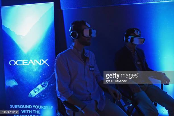 Guests enjoy a VR experience during the Launch Of OceanX a bold new initiative for ocean exploration at the American Museum of Natural History on...
