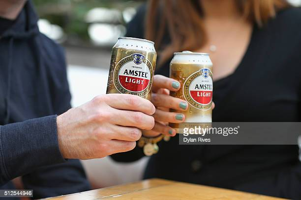 Guests enjoy Amstel Light Lager Beer at the Grilled Cheese Happy Hour Hosted By Laura Werlin And Ms Cheezious during 2016 Food Network Cooking...