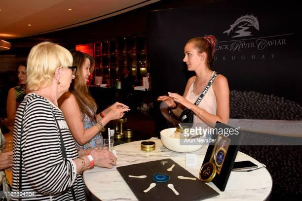 Guests enjoy Black River Caviar at Miami Swim Week Powered By Art Hearts Fashion Swim/Resort 2019/20 at Faena Forum on July 15 2019 in Miami Beach...