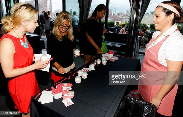 Guests enjoy desserts from L'Arte del Gelato during the New York Magazine Hosts Celebrity Cruises Pool Party at Dream Hotel on August 7 2013 in New...