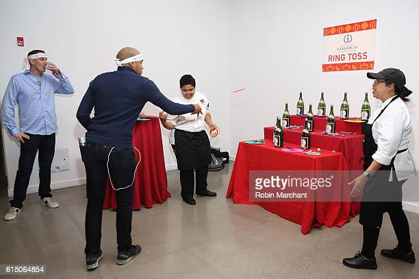 Guests enjoy Gekkeikan Ring Toss at Lucky Chopsticks An Asian Night Market hosted by Andrew Zimmern at Metropolitan West on October 16 2016 in New...
