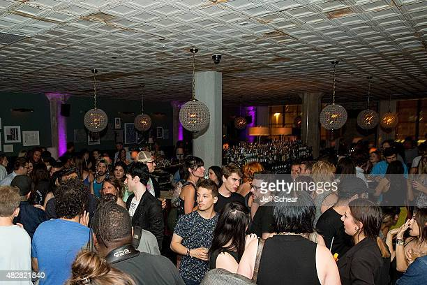 Guests enjoy Neon Gold Wrap Party @ Soho House Chicago with BACARDI on August 2, 2015 in Chicago, Illinois.