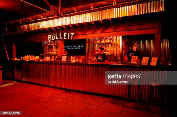 Guests enjoy specialty Bulleit Whiskey cocktails at the Italian Studies after party at The Battery Hosted By Bulleit Frontier Whiskey during the 2021...