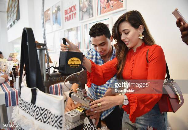 Guests enjoy the custom shoe bar during the DSW Block Party hosted by Olympians Adam Rippon and Mirai Nagasu on June 27 2018 at Ramscale Studio in...