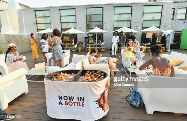 "Guests enjoy the delicious rich flavors of Bottled McCafé Frappés to celebrate Summ ""AHH"" Friday early at Spotify's Roof Deck on August 16 2018"