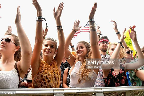 Guests enjoy the Knox Hamilton performance during day 2 of the Firefly Music Festival on June 19, 2015 in Dover, Delaware.