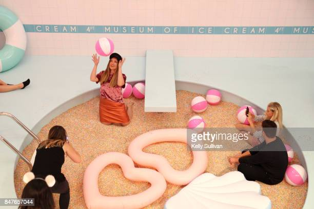 Guests enjoy the sprinkle pool at Museum of Ice Cream opening party on September 15 2017 in San Francisco California