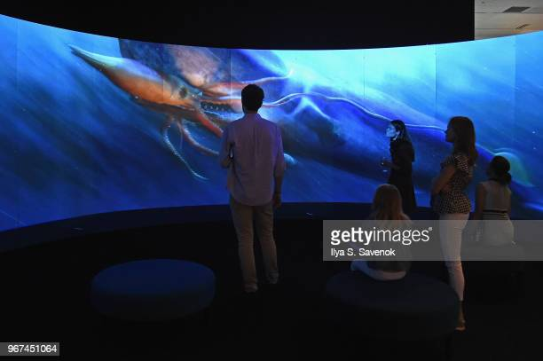 Guests enjoy the Unseen Oceans exhibit during the Launch Of OceanX a bold new initiative for ocean exploration at the American Museum of Natural...