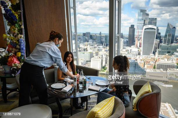Guests enjoy their meals at the Tang restaurant within the Shangri-La Hotel at The Shard on May 19, 2021 in London, England. From May 17, a wide raft...