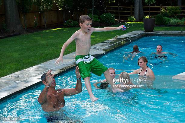 Guests enjoyed playing in the pool at the home of Greta De Keyser and Bart Vandaele's home in Alexandria Virginia on September 06 2014