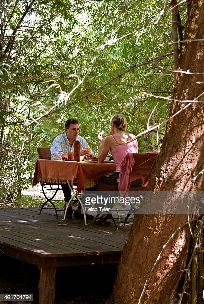 Guests enjoying lunch at Mahua Kothi a safari lodge on the edge of Baghavahn National Park Opened in late 2006 Mahua Kothi is a collaboration between...