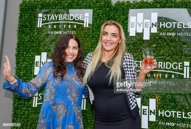 Guests enjoying the Grand Opening Event EVEN Hotel and Staybridge Suites Seattle on June 28 2018 in Seattle Washington