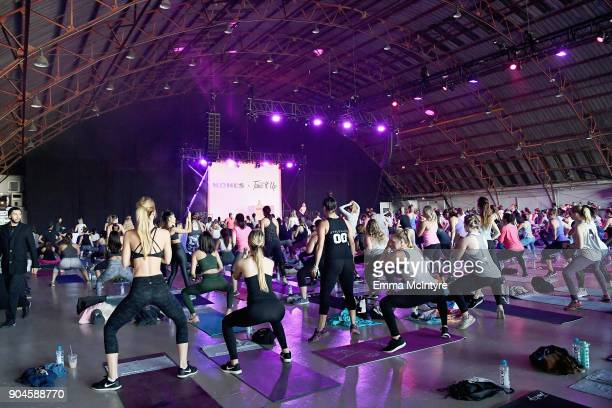 Guests exercise during Kohl's x Studio Tone It Up at Barker Hangar on January 13 2018 in Santa Monica California