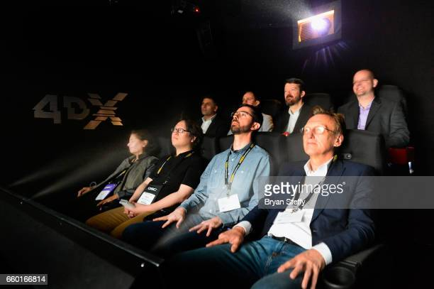 Guests experience the newly announced CJ 4DPLEX Co signature motion 'Twist and Sway' chairs during CinemaCon the official convention of the National...