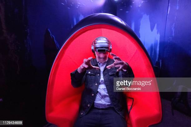 Guests experiencing the 'How To Train Your Dragon Hidden World' Virtual Tour at the Comcast NBCUniversal House at SXSW on March 9 2019 in Austin Texas
