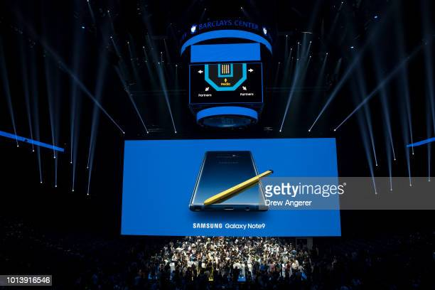 Guests flood the stage to view new products including the Samsung Galaxy Note 9 smartphone during a product launch event at the Barclays Center...