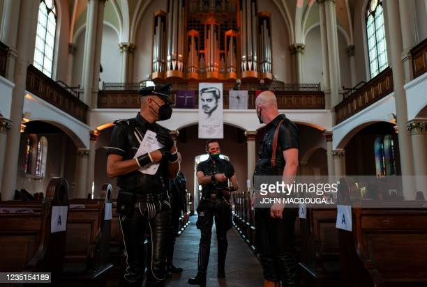 """Guests, fully clothed in leather, take their seats at the """"Classic meets Fetish"""" concert at the Twelve Apostles Church in Berlin on September 9, 2021."""