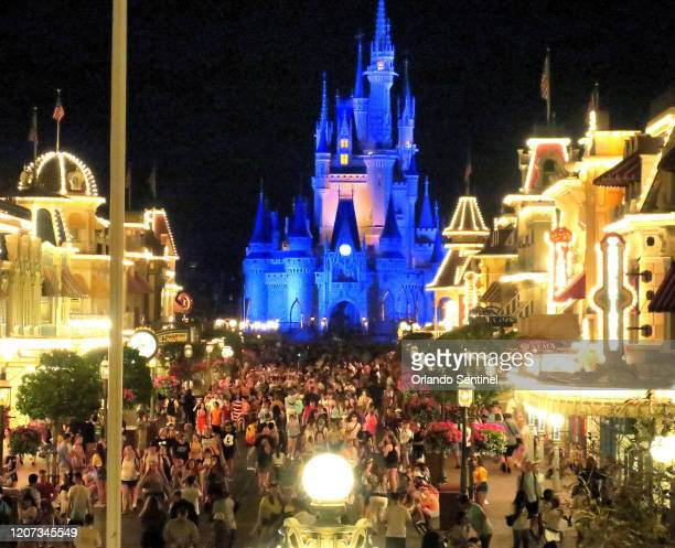 Guests gather on Main Street USA in the Magic Kingdom at Walt Disney World Sunday March 15 2020 in the final minutes before the park closed in Lake...