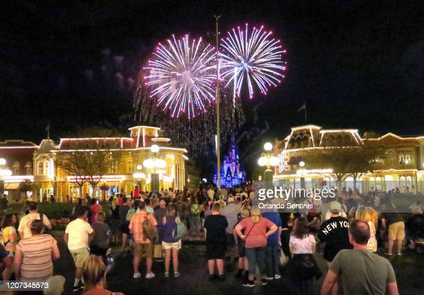 Guests gather on Main Street USA in the Magic Kingdom at Walt Disney World to watch fireworks before the park closed Sunday night March 15 in Lake...