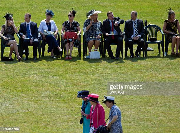 Guests gather on the lawn during a Garden Party at Buckingham Palace on June 6 2013 in London England