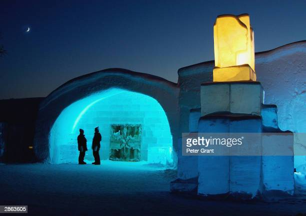 Guests gather outside the Ice Hotel January 2002 in Jukkasjarvi Sweden The 30 000 square foot hotel is constructed anew every year on the banks of...