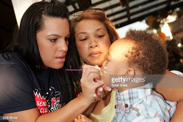 Guests get their faces painted during a fashion show and party to benefit the Make A Wish Foundation at The Park August 2 2005 in New York City