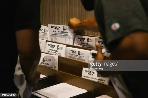Guests grab pick sheets during the launch of fullscale sports betting at Dover Downs Hotel and Casino in Dover Delaware US on Tuesday June 5 2018...