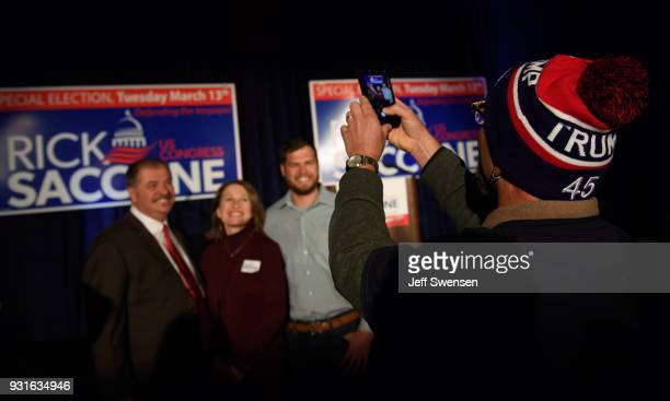 Guests have their photo taken at an Election Night event for GOP PA Congressional Candidate Rick Saccone as the polls close on March 13 2018 at the...