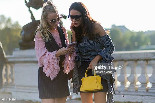 Guests having a look at their phone outside of Barbara Bui on September 29 2016 in Paris France