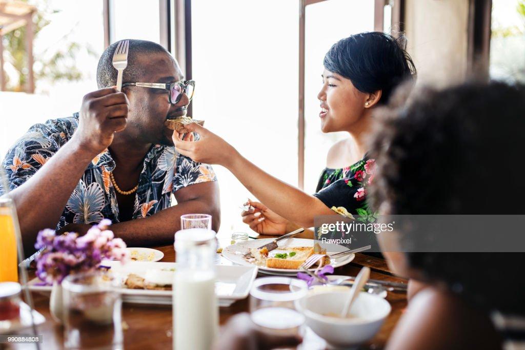 Guests having breakfast at hotel restaurant : Stock Photo