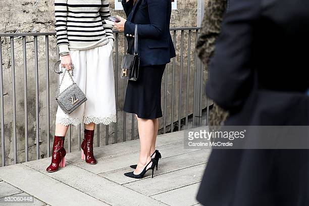 Guests holding Louis Vuitton and Hermes handbags arrive ahead of the KITX show at MercedesBenz Fashion Week Resort 17 Collections at Paddington...