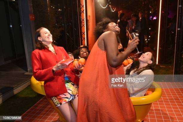 Guests in a bathtub pose for a selfie underneath a ceiling camera during the Spritz Plazza Party at the 118 Warner on September 19 2018 in Paris...