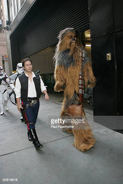 """Guests in costume as Han Solo and Chewbacca arrive at the premiere of """"Star Wars: Episode III Revenge Of The Sith"""", at the Ziegfeld Theater on May..."""
