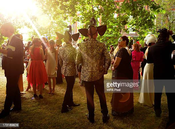 Guests in costume attend a reception hosted by Prince Charles Prince of Wales and Duchess of Cornwall a charity working to save the Asian Elephant...