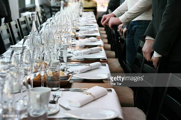 guests in front of table set for dinner - banquet stock pictures, royalty-free photos & images