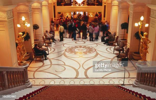 Guests in lobby of Corinthia Hotel.