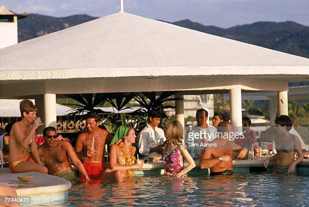 Guests in the pool at the Villa Vera Racquet Club, Acapulco, Mexico, 1968.