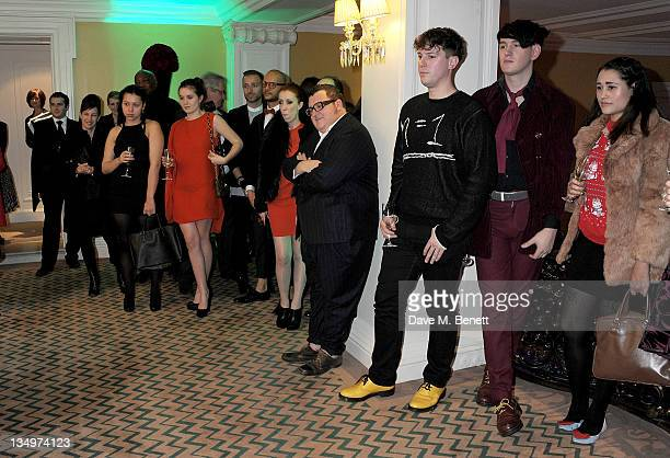 Guests including Amba Jackson and creative director of Lanvin Alber Elbaz watch Rosey Chan perform at Claridge's unveiling of the Alber Elbaz For...