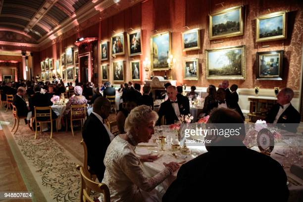 Guests including heads of Commonwealth nations and members of the British Royal Family attend the Queen's Dinner at Buckingham Palace in the week of...